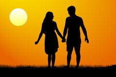 Силуэты людей и женщин стоя и держа руки на заходе солнца также вектор иллюстрации притяжки corel Стоковые Фотографии RF