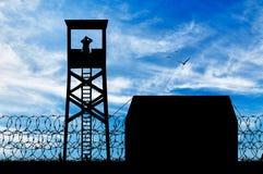 Силуэт лагерей беженцев и наблюдательных вышек Стоковые Фотографии RF