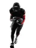 Силуэт американского бегуна футболиста идущий Стоковые Изображения RF