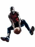 Силуэт африканского баскетболиста человека скача стоковое фото