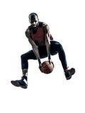 Силуэт африканского баскетболиста человека скача стоковое фото rf