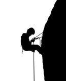 Силуэт альпиниста на скале Стоковая Фотография RF