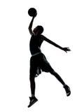 Силуэт баскетболиста dunking Стоковое фото RF