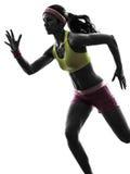 Силуэт бегуна женщины идущий стоковая фотография