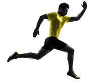Силуэт бегуна спринтера молодого человека идущий стоковые изображения