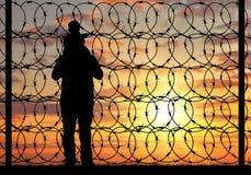 Силуэт беженца семьи Стоковая Фотография RF