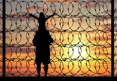 Силуэт беженца семьи Стоковое Изображение