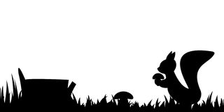 Силуэт белки в траве Стоковое Фото