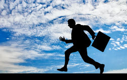 силуэт бизнесмена идущий Стоковое Изображение RF