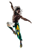 Силуэт бразильских танцев танцора чернокожего человека скача Стоковое Изображение RF
