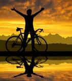 Силуэт велосипедиста Стоковые Изображения