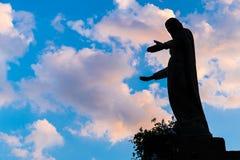 Силуэт девой марии Предпосылка соответствующая для различных религиозных и духовных концепций Стоковое Изображение