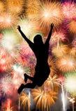 Силуэт девушки скача счастливый Стоковые Изображения