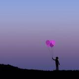 Силуэт детей с воздушным шаром Стоковые Изображения