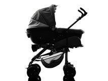 Силуэт детской дорожной коляски prams прогулочной коляски Стоковые Фото
