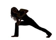 Силуэт женщины делая переплетенный выпад в йоге стоковые фотографии rf