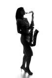 Силуэт женщины с саксофоном Стоковая Фотография
