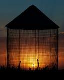 Силуэт захода солнца ящика зерна Стоковая Фотография RF
