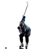 Силуэт игрока человека хоккея на льде Стоковое фото RF