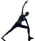 Силуэт йоги представления строба parighasana женщины Стоковое фото RF
