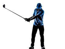 Силуэт качания гольфа игрока в гольф человека играя в гольф Стоковое Фото
