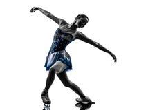 Силуэт конькобежца женщины катаясь на коньках Стоковое Фото