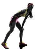 Силуэт корчи мышцы боли бегуна женщины идущий Стоковые Фотографии RF