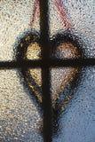 Силуэт креста и сердца Стоковое Изображение RF