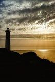 Силуэт маяка Стоковые Изображения