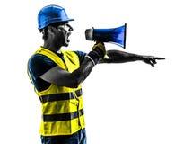 Силуэт мегафона signaling рабочий-строителя Стоковые Изображения RF