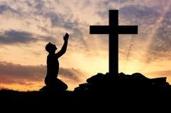 Силуэт молить человека Стоковое Изображение RF