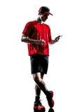 Силуэт наушников smartphones jogger бегуна Стоковая Фотография RF