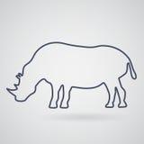Силуэт носорога на свете - серой предпосылки Под серым цветом носорога Стоковые Изображения RF