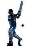 Силуэт отбивающего мяч игрока сверчка Стоковая Фотография RF