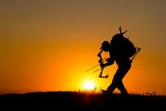 Силуэт охотника смычка Стоковое Фото