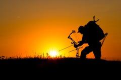 Силуэт охотника смычка Стоковая Фотография