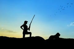 Силуэт охотника Стоковые Изображения