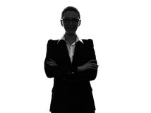 Силуэт портрета бизнес-леди пересеченный оружиями Стоковое Фото