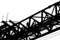 Силуэт работника работая на машине раскрытия прогона моста Стоковое Изображение