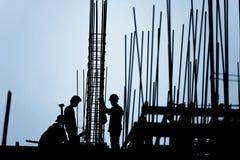 Силуэт рабочий-строителя Стоковые Изображения