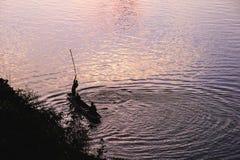Силуэт рыболова Стоковое Изображение RF