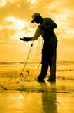 Силуэт рыболовов ремонтирует его nett Стоковое фото RF