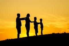 силуэт семьи счастливый Стоковое Изображение RF