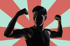 Силуэт сильного человека стоковая фотография