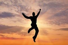 Силуэт скакать человека Стоковое Изображение RF