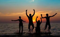Силуэт скача людей Стоковая Фотография RF