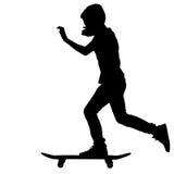 Силуэт скейтбордистов Стоковое фото RF
