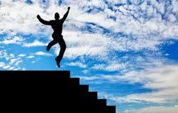 Силуэт счастливый скакать бизнесмена Стоковые Фотографии RF