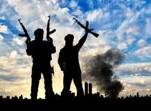 Силуэт террористов и города Стоковая Фотография RF