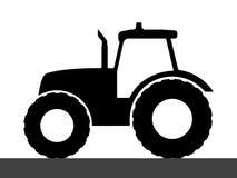 Силуэт трактора на белой предпосылке Стоковые Фотографии RF